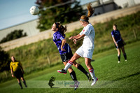 Best soccer pictures of UW Madison Women's Club Soccer player heading the ball