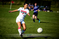 Picture of UW Madison Women's Club Soccer player kicking the ball