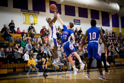 Corian Davis takes a shot at DeForest Boys Basketball vs Janesville Craig February 2016